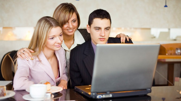 Three of Business People at the Laptop