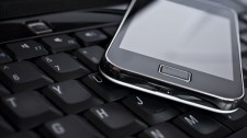 Cell phone on laptop keyboard