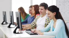 education-technology-school-and-people-concept-group-of-smiling-students-working-with-computers-in-computer-class-at-school_vuletns3e__F0000